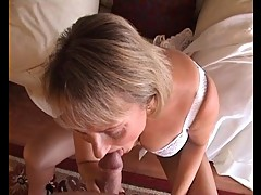 Classy Mature Blonde in garters and lace orally satisfies her man!