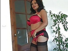 Heavy chested dark haired milf in lingerie plays with her ha...