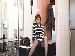 Brunette In A Striped Dress Is In The Dressing Room Posing