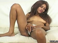 Mature Black woman plays her wet pussy
