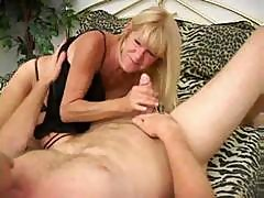 Mature Tanned Blonde In Action