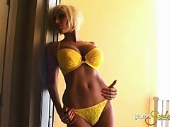 Sexy blond mom Pume Swede showing off her new yellow bikini for guys
