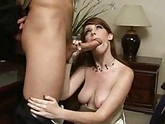 Sexy brunette grabs onto cock to do a hand job and suck dick